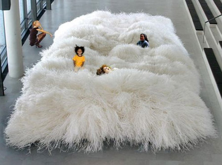 A carpet made out of paper yarn that transforms itself from a  two-dimensional into a three-dimensional object that can be shaped and  modeled in an endless ...