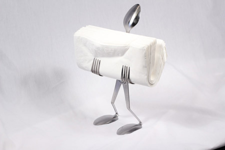 This little guy holds your napkins, gets laughs every time, and will  brighten the table for you and those around.