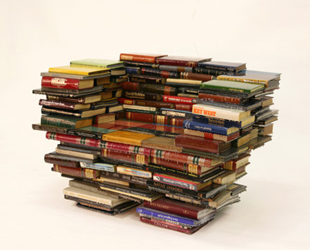 This Chair Is Constructed From Stacked Books To Create A Stable Structure,  Then Coated With What Appears To Be Many Layers Of Polyurethane, In The  Hopes Of ...